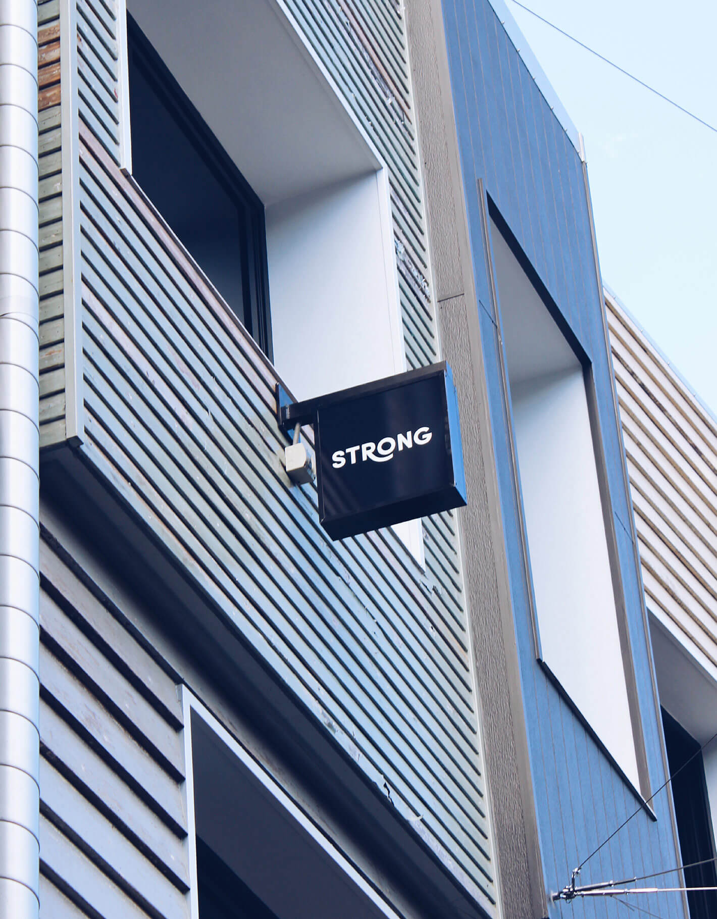 Sign outside strong digital office showing brand identity