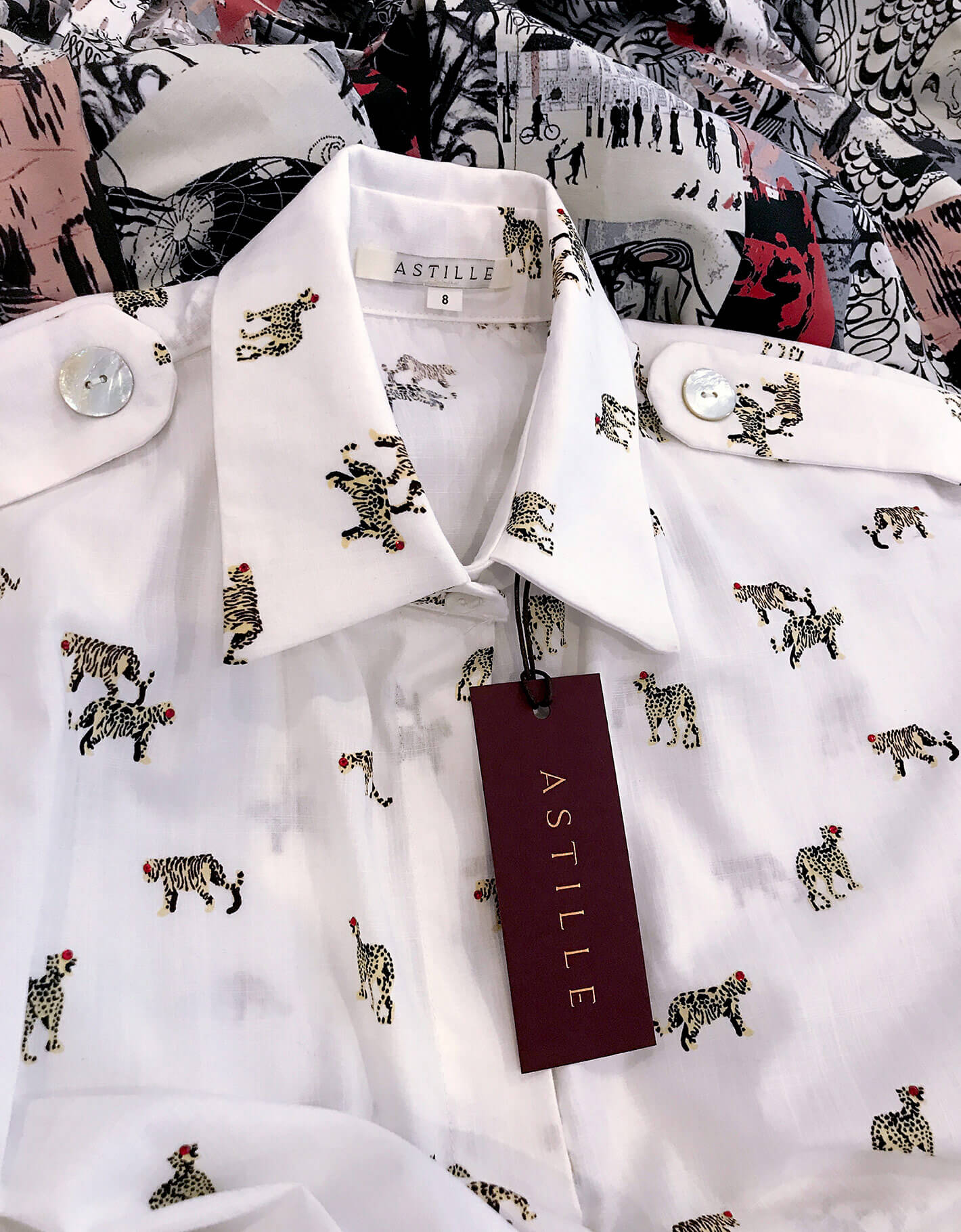 Astille foiled swingtag sity on Leopard print shirt dress by Astille Designs