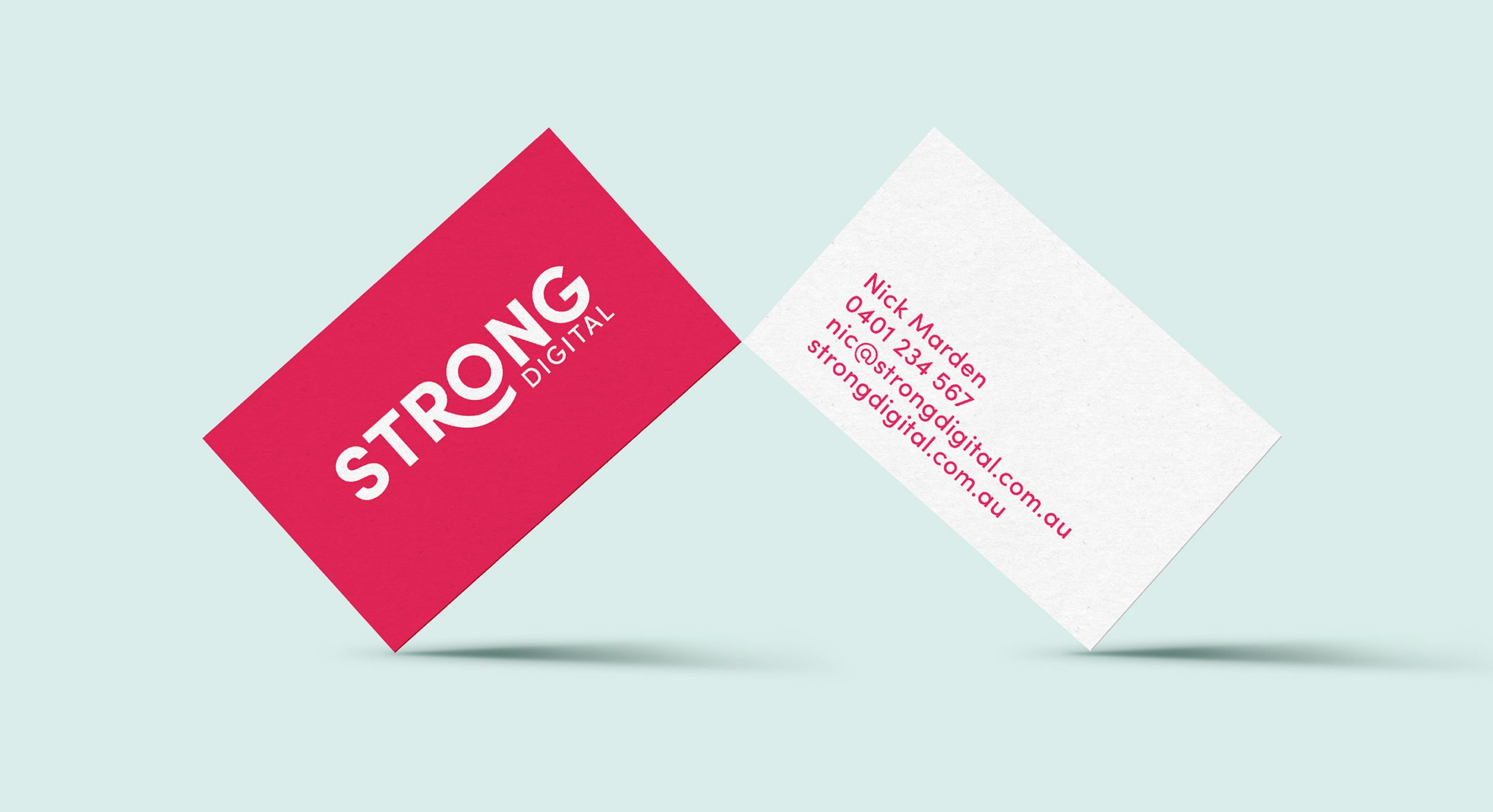 business cards for strong digital team members showing bright prink highligh colour from brand palette