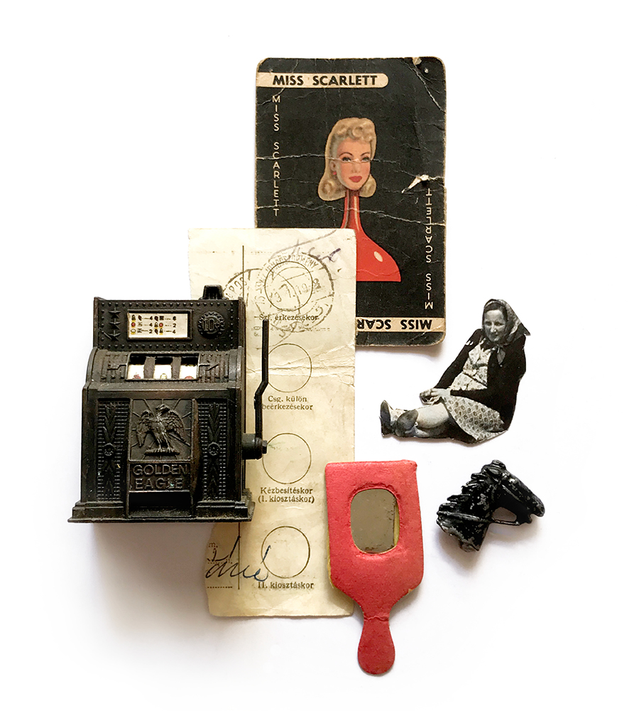 photograph of found item collage of vintage objects like novelty sharpener, dollhouse mirror, tin horse model, cluedo card