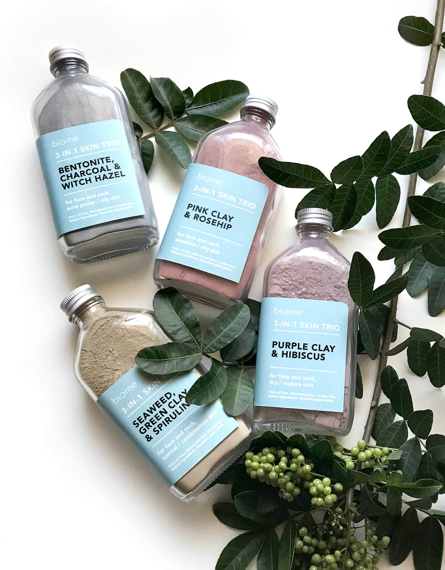 Flaylay of natural beauty packaging for clay mask with cool blue labels and minimal design