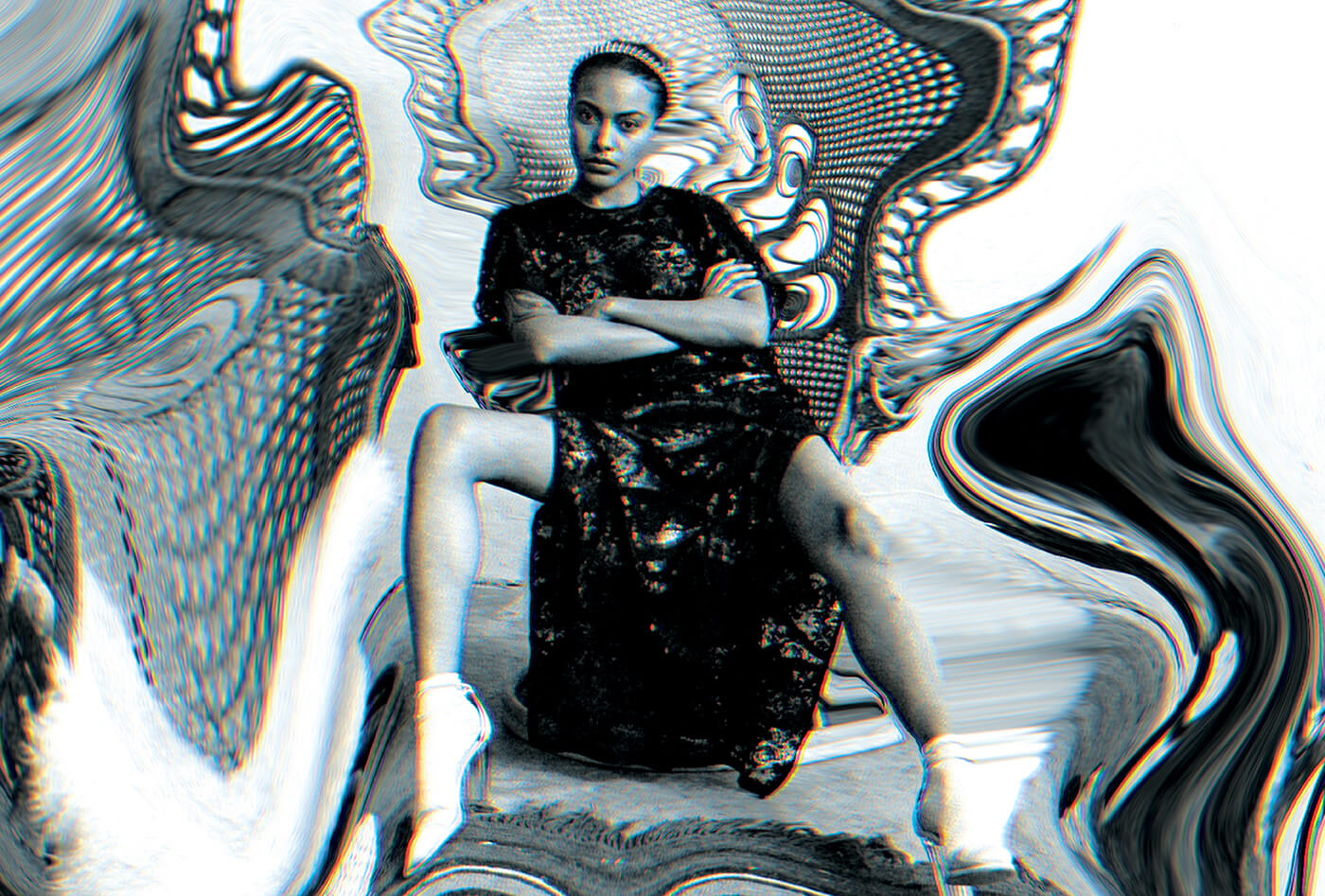 black and white campaign image of woman that has been glitched
