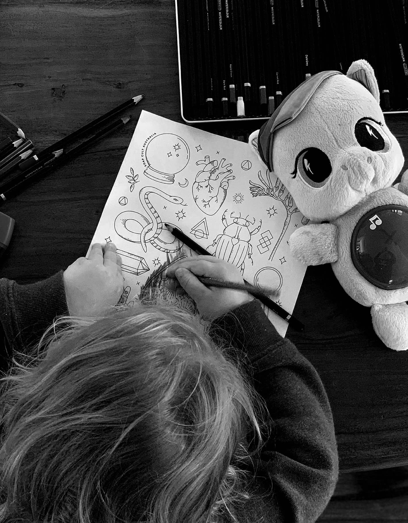 Child colouring in Soap Cult Australia colouring in competition.