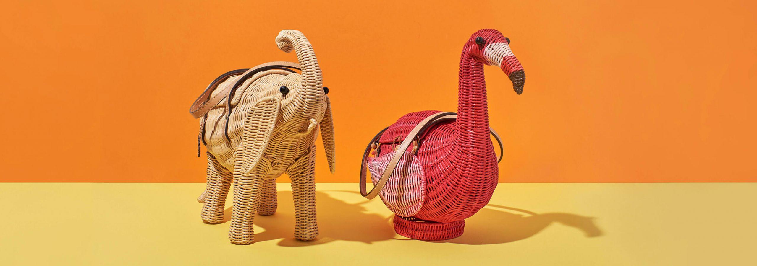 Image of elephant and flamingo wicker shaped handbag on orange background.